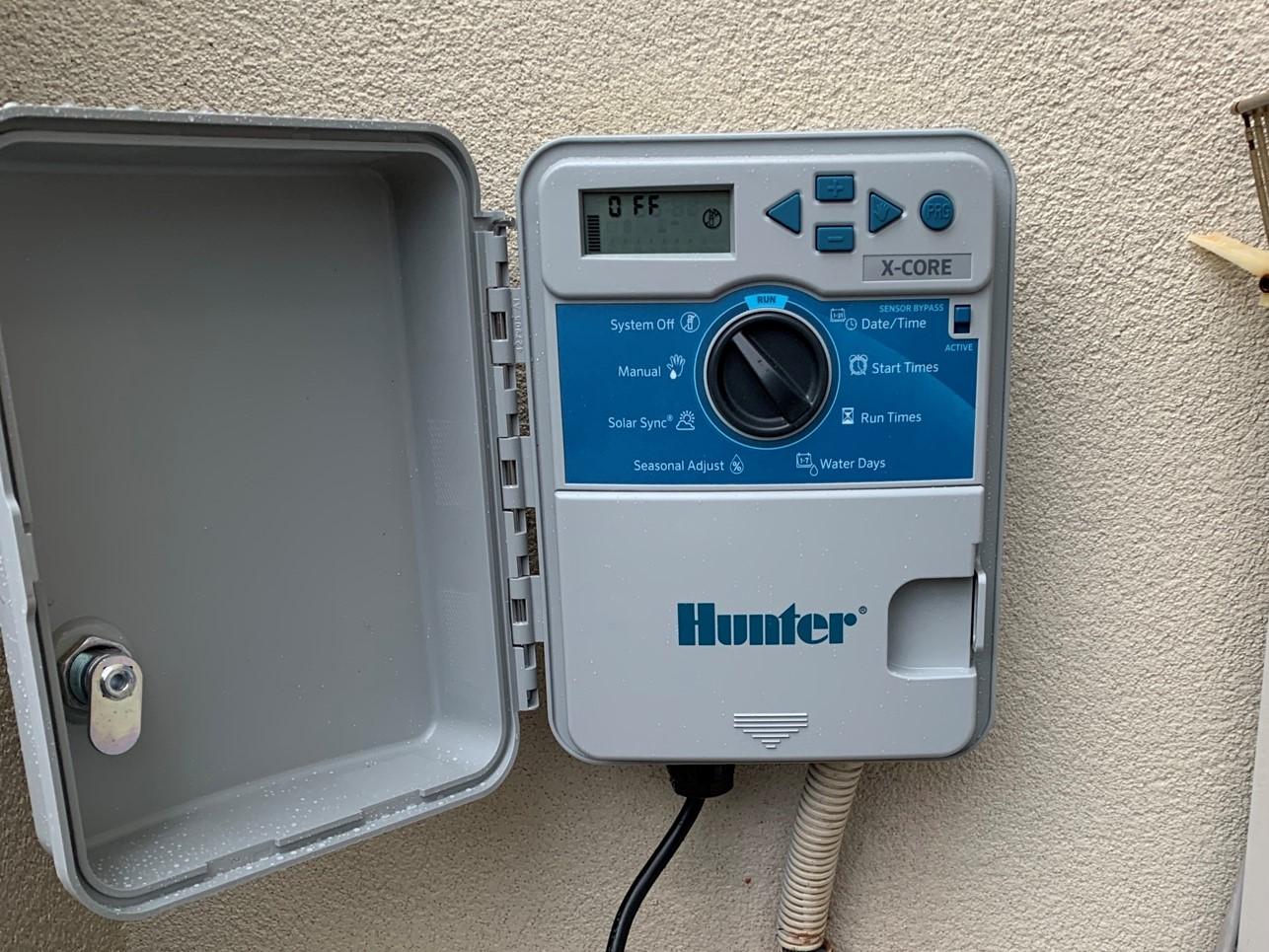 A Hunter Industries Water Controller installed in Como