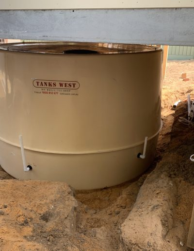 An installed rainwater tank underneath a Perth resident's patio