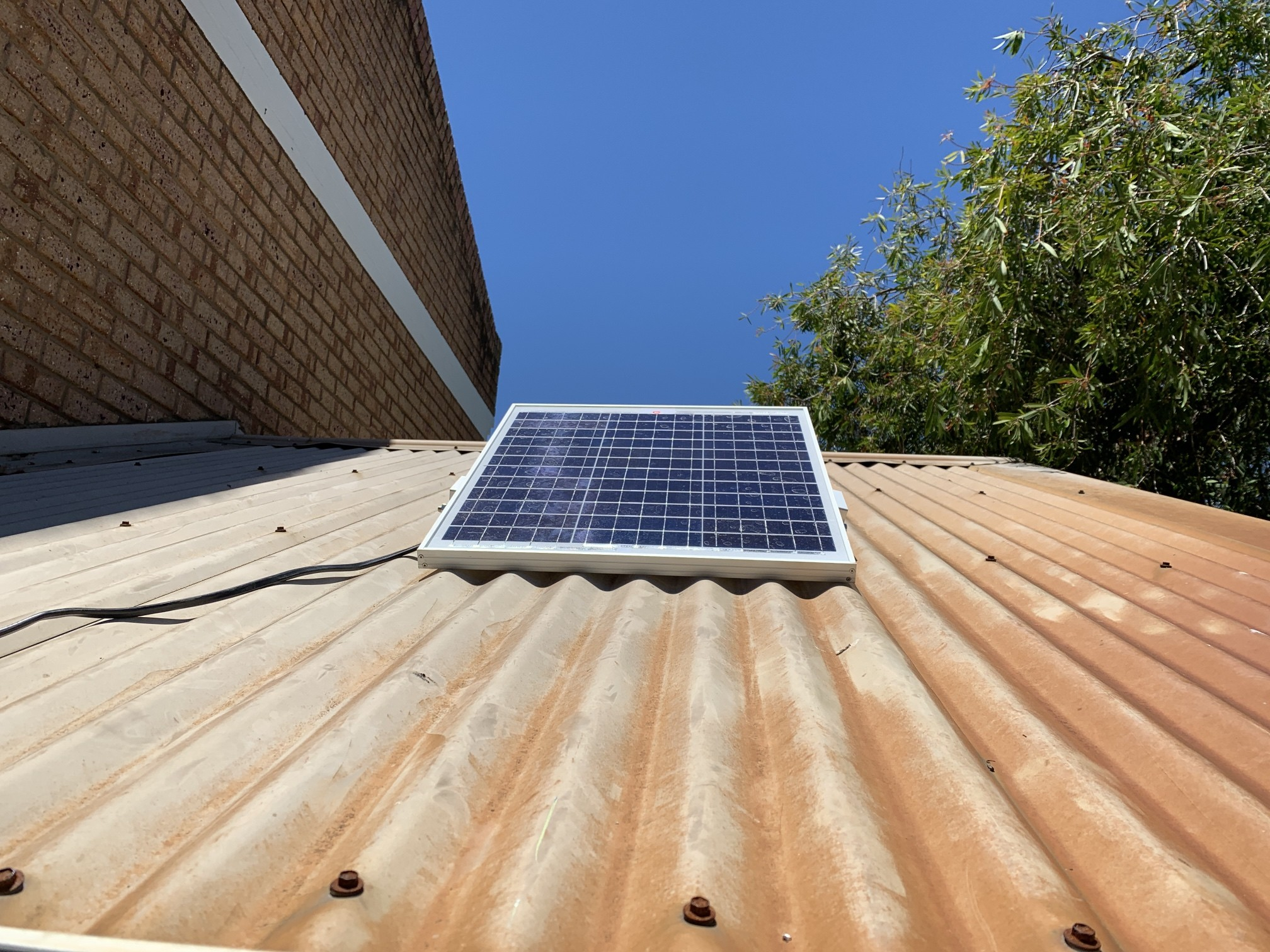 Solar panel powering a Perth rainwater system